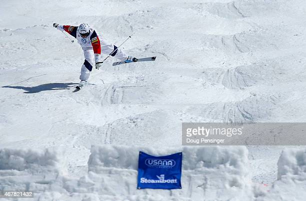 Jeremy Cota crashes in the finals of the men's moguls at the 2015 US Freestyle Ski Championships at the Steamboat Ski Resort on March 27 2015 in...