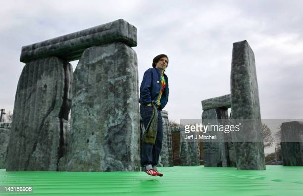 Jeremy Deller bounces on his new artwork Sacrilege as it is launched as part of the Glasgow International Festival of Visual Arts at Glasgow Green on...