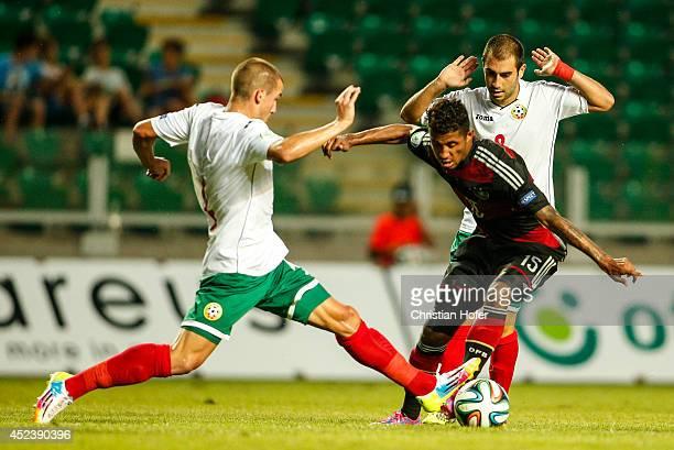Jeremy Dudziak of Germany challenges Preslav Petrov and Nikola Peychev Kolev of Bulgaria during the UEFA Under19 European Championship match between...