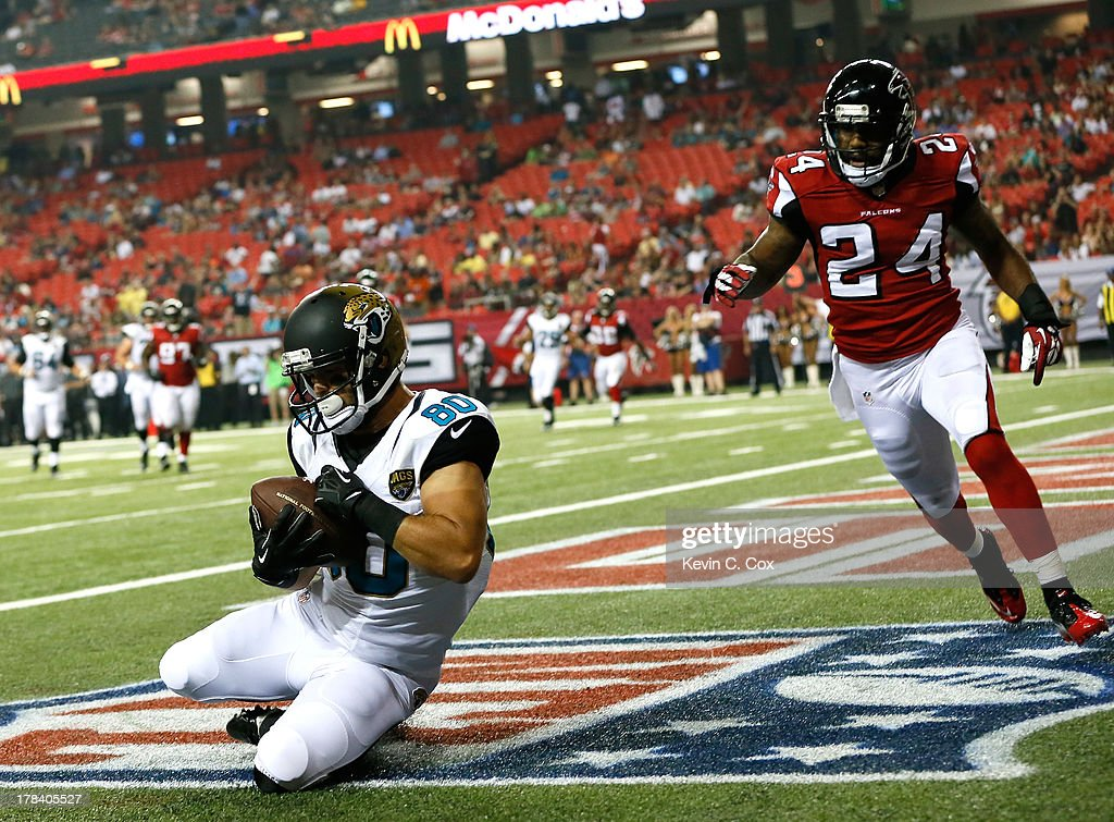 Jeremy Ebert #80 of the Jacksonville Jaguars pulls in a touchdown reception against Dominique Franks #24 of the Atlanta Falcons at Georgia Dome on August 29, 2013 in Atlanta, Georgia.