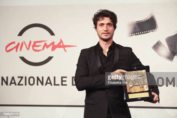 Jeremy Elkaim poses with his Best Actor Award during the Award Winners Photocall during the 7th Rome Film Festival at Auditorium Parco Della Musica...