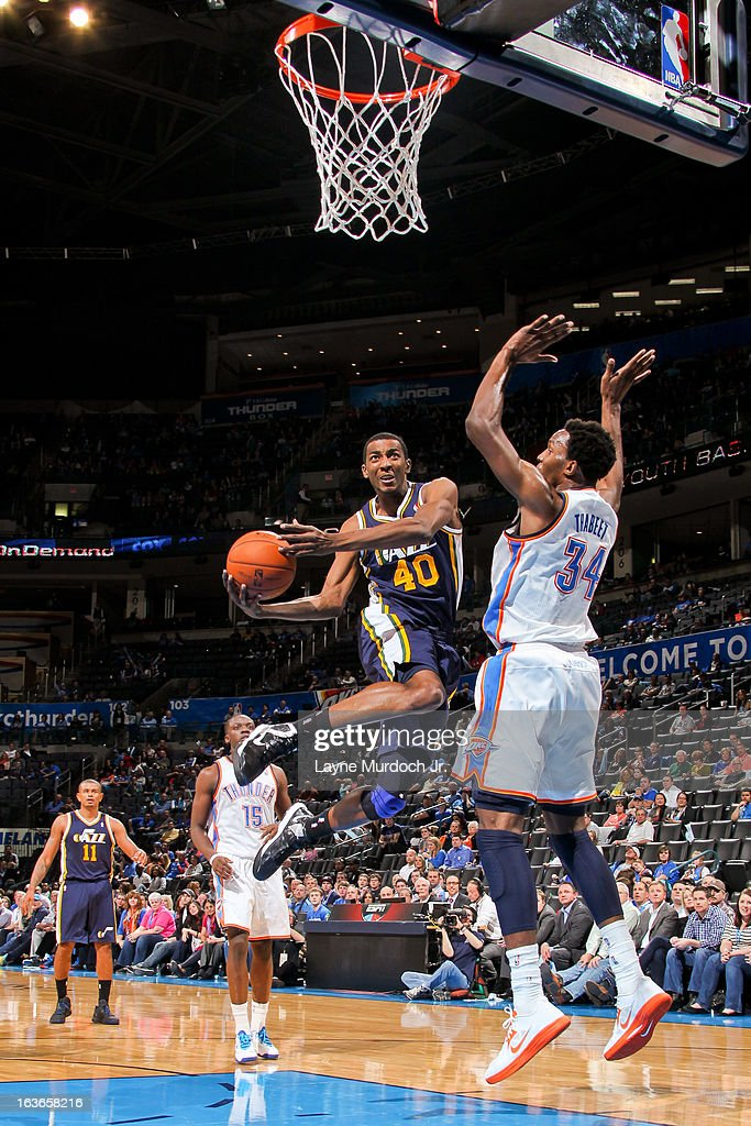 Jeremy Evans #40 of the Utah Jazz drives to the basket against <a gi-track='captionPersonalityLinkClicked' href=/galleries/search?phrase=Hasheem+Thabeet&family=editorial&specificpeople=4003778 ng-click='$event.stopPropagation()'>Hasheem Thabeet</a> #34 of the Oklahoma City Thunder on March 13, 2013 at the Chesapeake Energy Arena in Oklahoma City, Oklahoma.