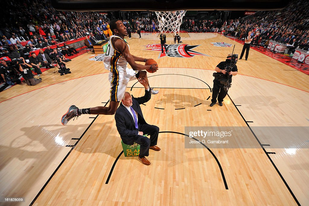 Jeremy Evans of the Utah Jazz dunks over Mark Eaton during the 2013 Sprite Slam Dunk Contest on State Farm All-Star Saturday Night as part of the 2013 NBA All-Star Weekend on February 16, 2013 at the Toyota Center in Houston, Texas.