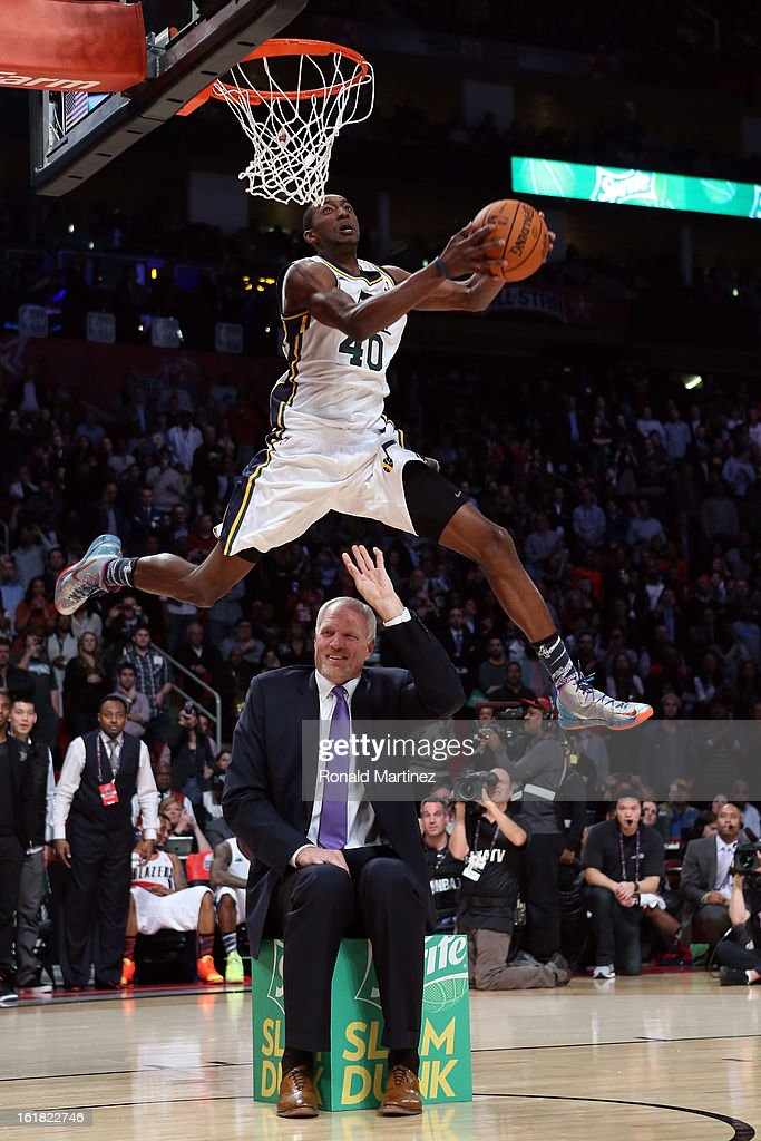 Jeremy Evans of the Utah Jazz dunks the ball over former Jazz player Mark Eaton in the first round during the Sprite Slam Dunk Contest part of 2013...