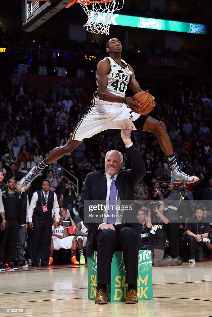 Jeremy Evans of the Utah Jazz dunks the ball over former Jazz player Mark Eaton in the first round during the Sprite Slam Dunk Contest part of 2013 NBA All-Star Weekend at the Toyota Center on February 16, 2013 in Houston, Texas.