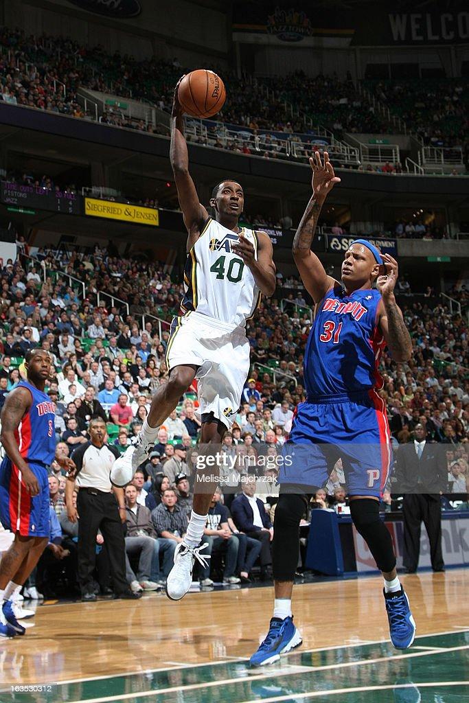 Jeremy Evans #40 of the Utah Jazz shoots against Charlie Villanueva #31 of the Detroit Pistons at Energy Solutions Arena on March 11, 2013 in Salt Lake City, Utah.
