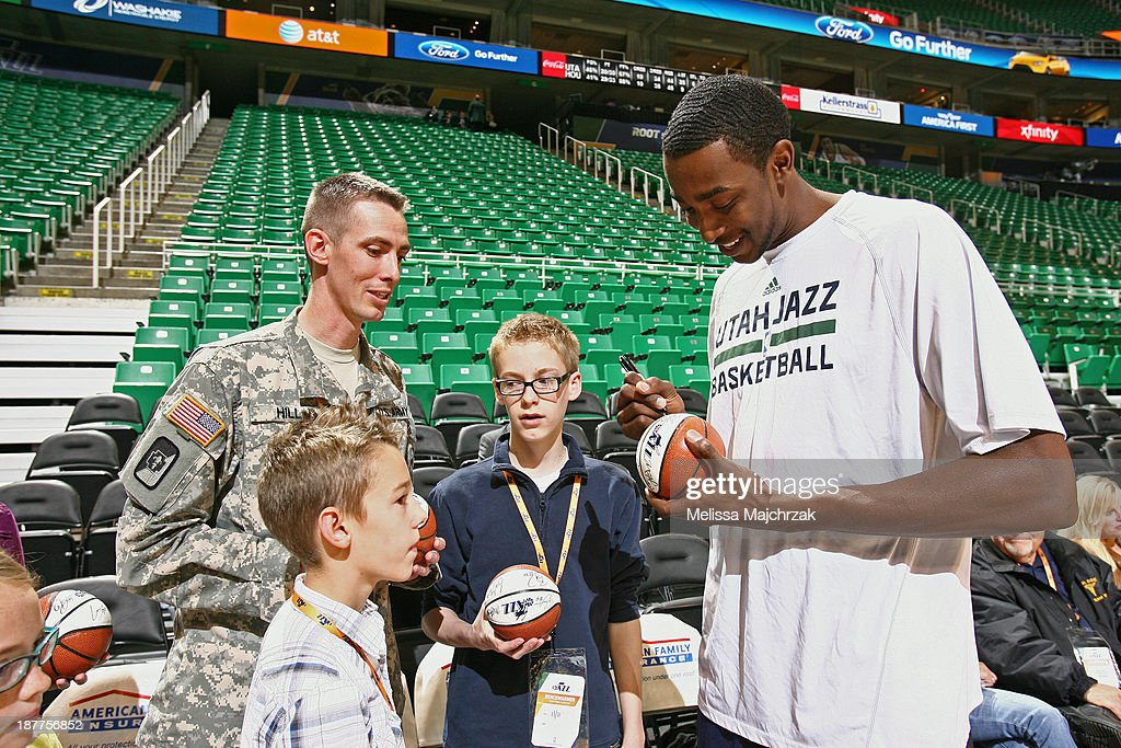 Jeremy Evans #40 of the Utah Jazz signs autographs before the game against the Denver Nuggets at EnergySolutions Arena on November 11, 2013 in Salt Lake City, Utah.