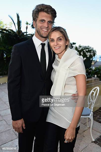 Jeremy Everett and creative director of the Italian jewellery brand Repossi Gaia Repossi pose as they attend the launch of the 'White noise'...