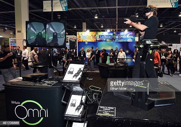 Jeremy Gaddis uses the Virtuix Omni an omnidirectional treadmill virtual reality gaming system with Oculus Rift at the 2015 International CES at the...