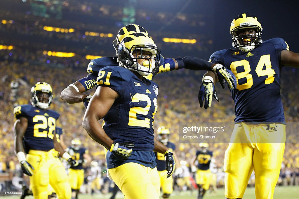 Jeremy Gallon of the Michigan Wolverines celebrates a first quarter touchdown against the Notre Dame Fighting Irish during the game at Michigan...