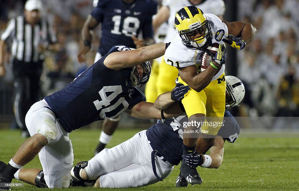 <a gi-track='captionPersonalityLinkClicked' href=/galleries/search?phrase=Jeremy+Gallon&family=editorial&specificpeople=7210704 ng-click='$event.stopPropagation()'>Jeremy Gallon</a> #21 of the Michigan Wolverines rushes against the Penn State Nittany Lions during the game on October 12, 2013 at Beaver Stadium in State College, Pennsylvania.