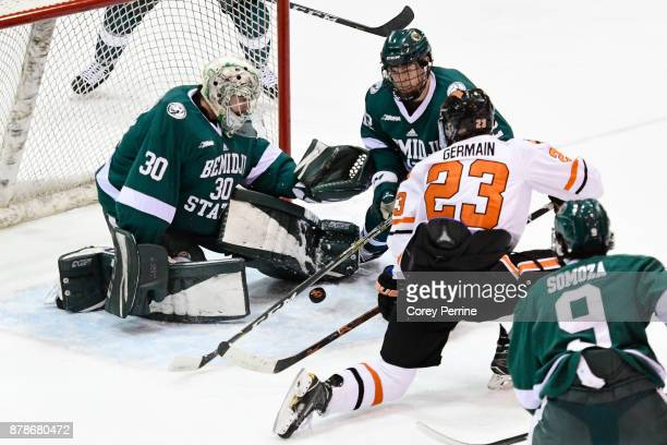 Jeremy Germain of the Princeton Tigers can't score on Jack Burgart as Dylan McCrory of the Bemidji State Beavers defends during the first period at...