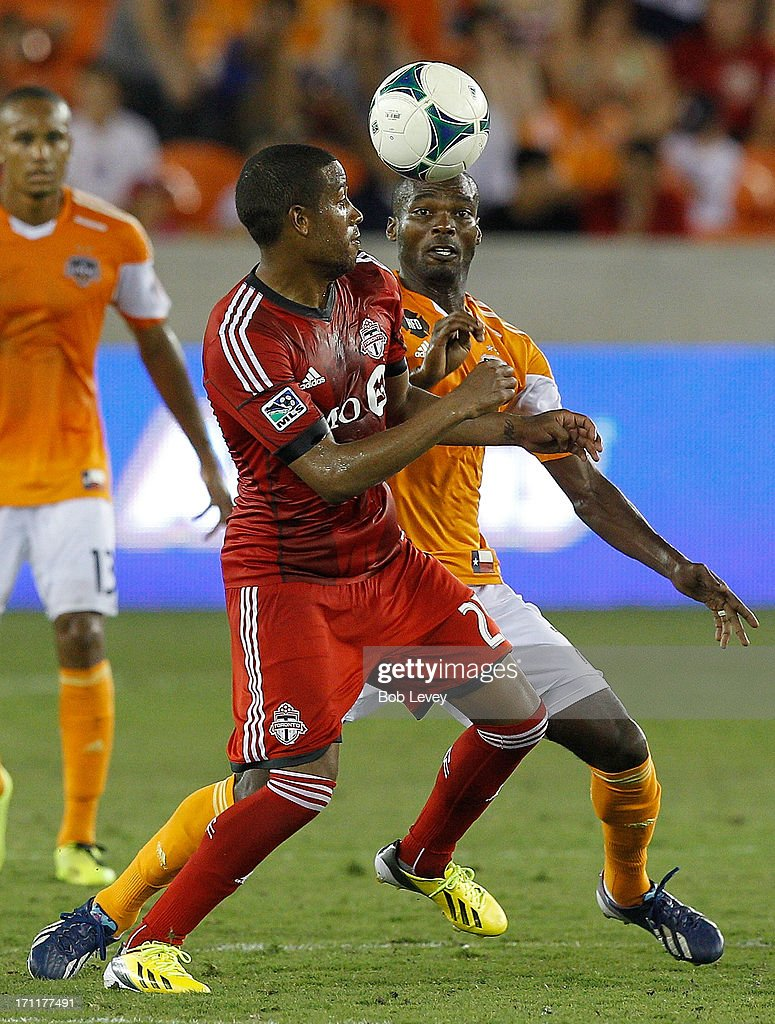 Jeremy Hall of Toronto FC and Omar Cummings of Houston Dynamo battle for the ball in the second half at BBVA Compass Stadium on June 22 2013 in...
