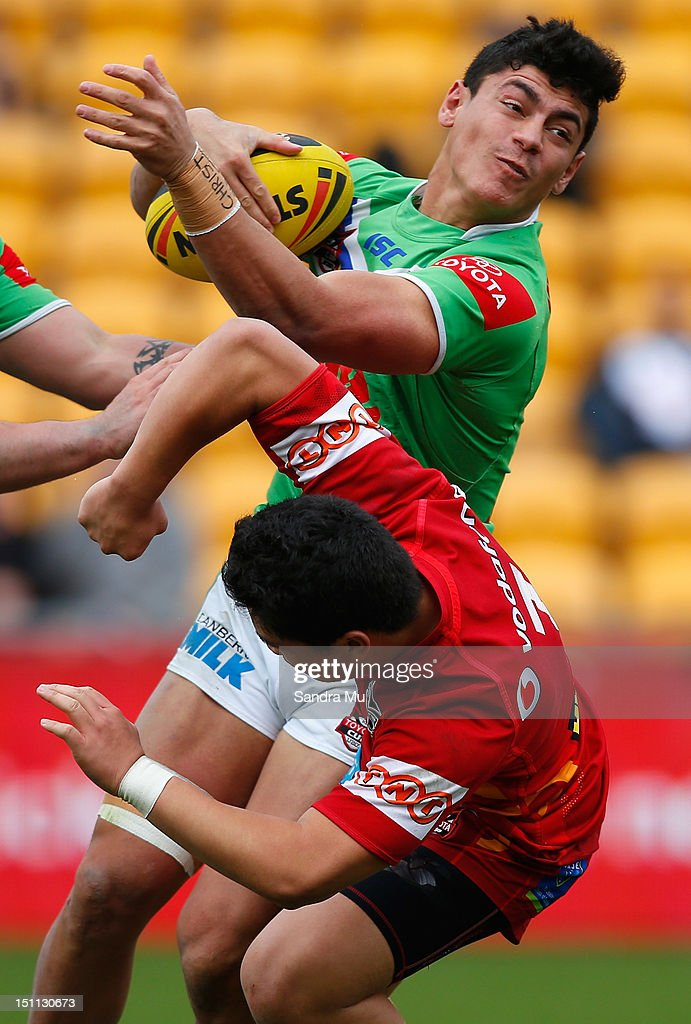 Jeremy Hawkins of the Junior Raiders colides into Mason Lino of the Junior Warriors during the Toyota Cup round 26 match between the New Zealand Warriors and the Canberra Raiders at Mt Smart Stadium on September 2, 2012 in Auckland, New Zealand.