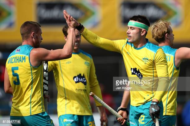 Jeremy Hayward of Australia celebrates his goal with team mates during day 5 of the FIH Hockey World League Men's Semi Finals Pool A match between...