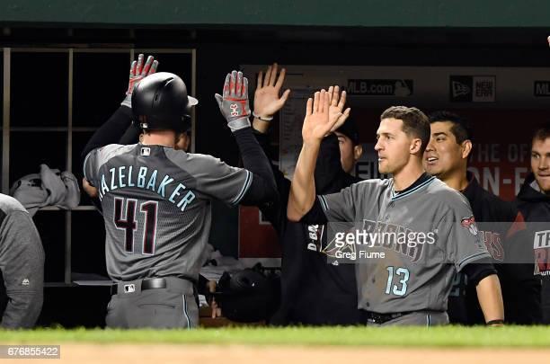 Jeremy Hazelbaker of the Arizona Diamondbacks celebrates with teammates after hitting a home run in the ninth inning against the Washington Nationals...