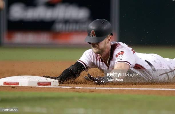 Jeremy Hazelbaker of the Arizona Diamondbacks slides into third base with a triple against the San Francisco Giants during the second inning of a MLB...