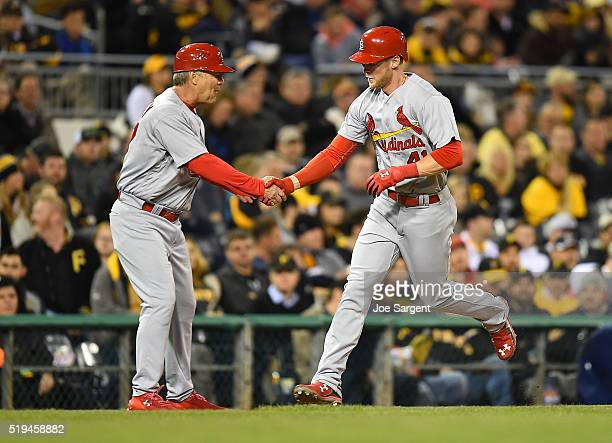 Jeremy Hazelbaker of the St Louis Cardinals celebrates his first career home run with third base coach Chris Maloney during the sixth inning against...