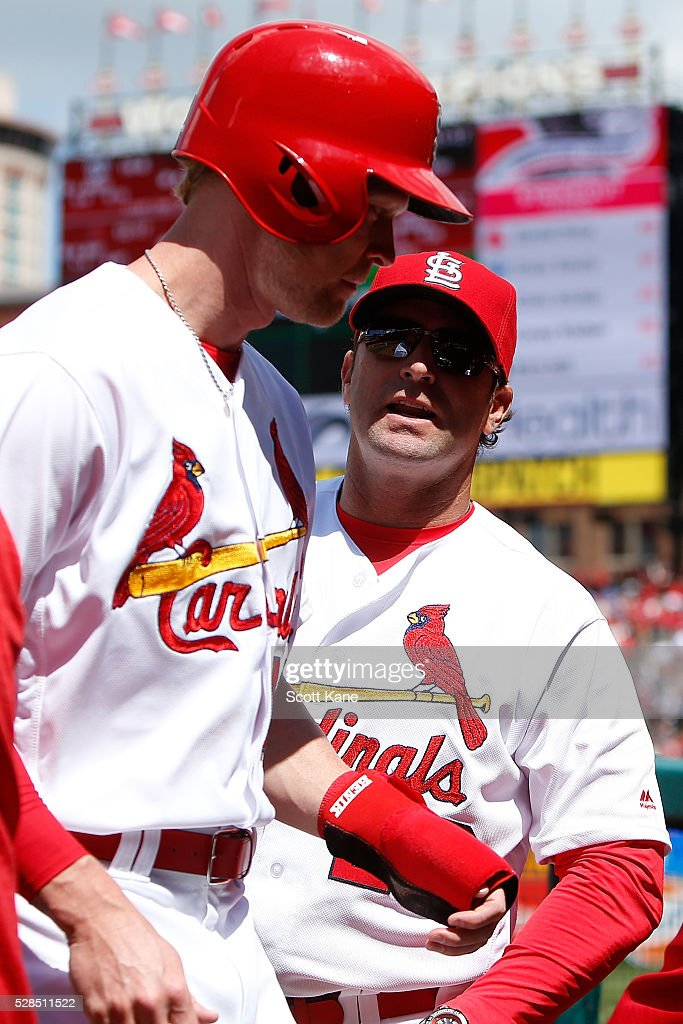 Jeremy Hazelbaker #41 of the St. Louis Cardinals is congratulated by manager Mike Matheny #22 as he enters the dugout after scoring a run during the seventh inningagainst the Philadelphia Phillies at Busch Stadium on May 5, 2016 in St. Louis, Missouri.