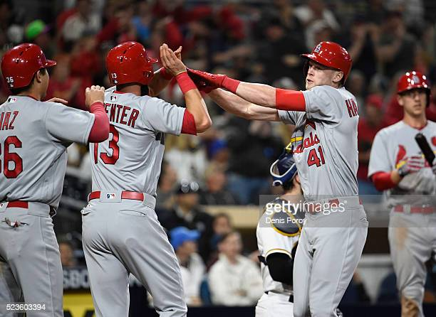 Jeremy Hazelbaker of the St Louis Cardinals right is congratulated by Matt Carpenter and Aledmys Diaz after hitting a threerun home run during the...