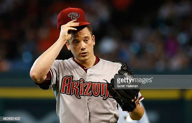 Jeremy Hellickson of the Arizona Diamondbacks reacts to allowing a walk in the fourth inning during their game against the Houston Astros at Minute...