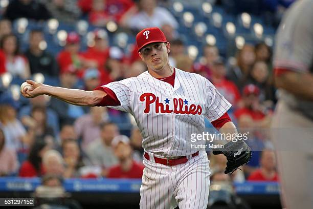 Jeremy Hellickson of the Philadelphia Phillies throws to first base after fielding a ground ball in the second inning during a game against the...