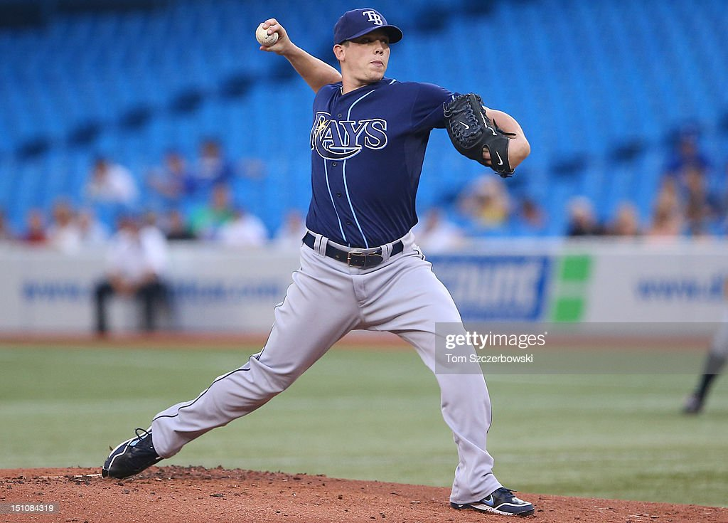 <a gi-track='captionPersonalityLinkClicked' href=/galleries/search?phrase=Jeremy+Hellickson&family=editorial&specificpeople=2364859 ng-click='$event.stopPropagation()'>Jeremy Hellickson</a> #58 of the Tampa Bay Rays delivers a pitch during MLB game action against the Toronto Blue Jays on August 31, 2012 at Rogers Centre in Toronto, Ontario, Canada.