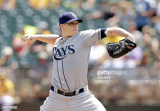 Jeremy Hellickson of the Tampa Bay Rays pitches against the Oakland Athletics in the first inning at Oco Coliseum on August 6 2014 in Oakland...