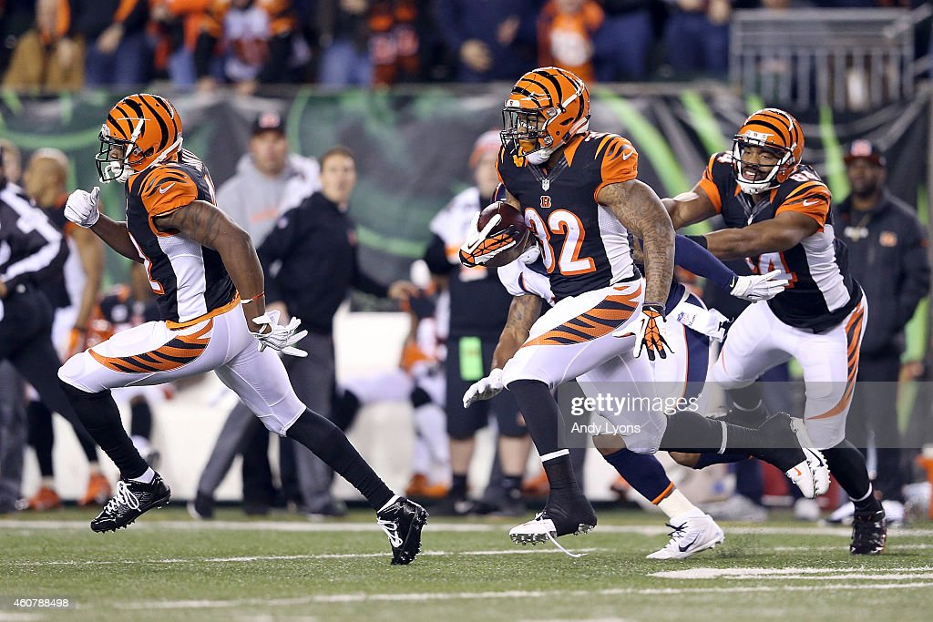 Jeremy Hill #32 of the Cincinnati Bengals carries the ball for an 85 yard touchdown run during the first quarter of the game against the Denver Broncos at Paul Brown Stadium on December 22, 2014 in Cincinnati, Ohio.