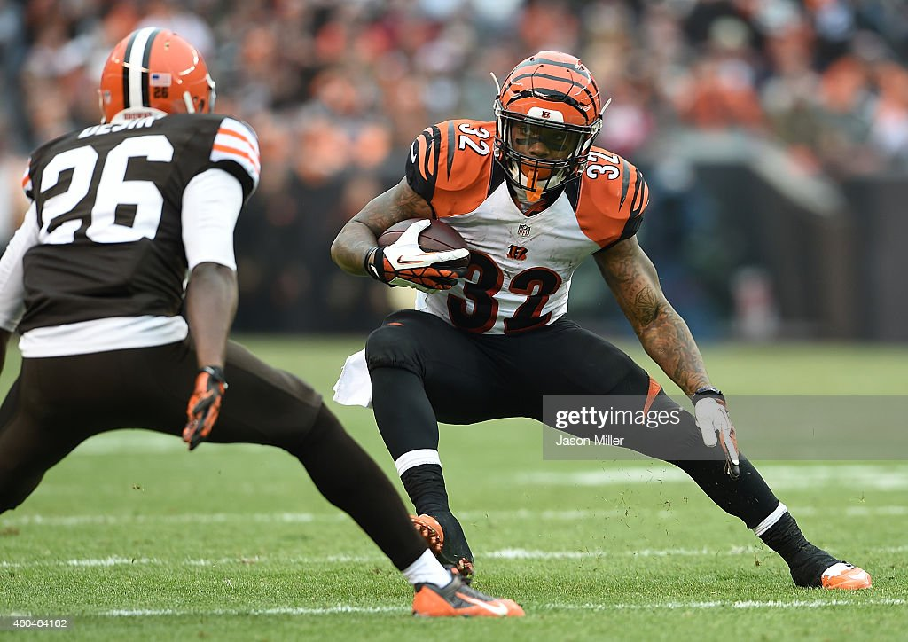 <a gi-track='captionPersonalityLinkClicked' href=/galleries/search?phrase=Jeremy+Hill+-+American+Football+Player&family=editorial&specificpeople=11392891 ng-click='$event.stopPropagation()'>Jeremy Hill</a> #32 of the Cincinnati Bengals carries the ball in front of <a gi-track='captionPersonalityLinkClicked' href=/galleries/search?phrase=K%27Waun+Williams&family=editorial&specificpeople=8222224 ng-click='$event.stopPropagation()'>K'Waun Williams</a> #36 of the Cleveland Browns during the second quarter at FirstEnergy Stadium on December 14, 2014 in Cleveland, Ohio.