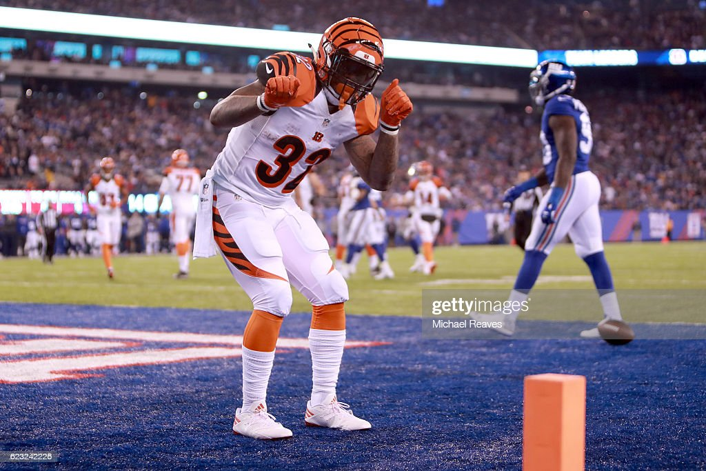 Jeremy Hill #32 of the Cincinnati Bengals celebrates after scoring a 9 yard touchdown against the New York Giants during the third quarter of the game at MetLife Stadium on November 14, 2016 in East Rutherford, New Jersey.