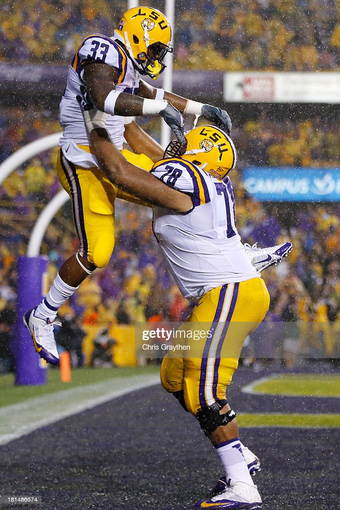 Jeremy Hill #33 of the LSU Tigers and Vadal Alexander #78 celebrate after Hill scored a touchdown against the Auburn Tigers at Tiger Stadium on September 21, 2013 in Baton Rouge, Louisiana.