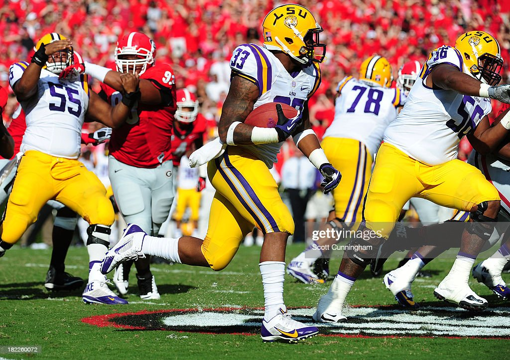 Jeremy Hill #33 of the LSU Tigers carries the ball against the Georgia Bulldogs at Sanford Stadium on September 28, 2013 in Athens, Georgia.