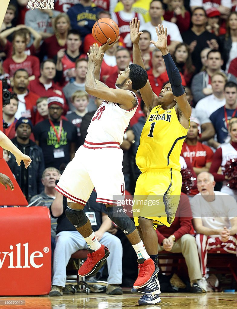 Jeremy Hollowell #33 of the Indiana Hoosiers shoots the ball while defended by Glenn Robinson III #1 of the Michigan Wolverines during the game at Assembly Hall on February 2, 2013 in Bloomington, Indiana.