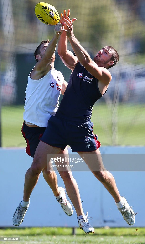Jeremy Howe (L) and Colin Garland contest for the ball during a Melbourne Demons AFL training session at Gosch's Paddock on May 2, 2013 in Melbourne, Australia.