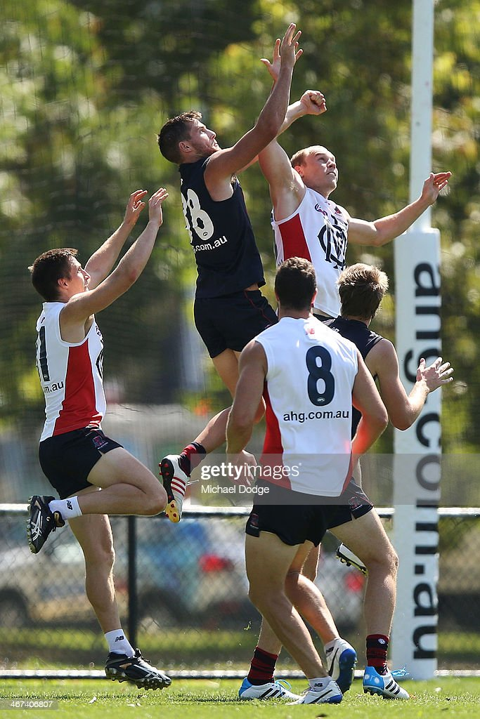 Jeremy Howe jumps for the ball during a Melbourne Demons AFL training session at Gosch's Paddock on February 7, 2014 in Melbourne, Australia.