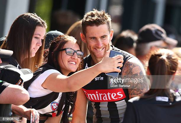 Jeremy Howe of the Collingwood Magpies poses for a selfie with a supporter in the crowd after a Collingwood Magpies Training Session on April 7 2016...