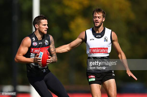 Jeremy Howe of the Collingwood Magpies runs with the ball as Ben Reid looks on during a Collingwood Magpies Training Session on April 7 2016 in...