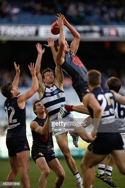 Jeremy Howe of the Demons attempts a high mark during the round 17 AFL match between the Melbourne Demons and the Geelong Cats at Melbourne Cricket...