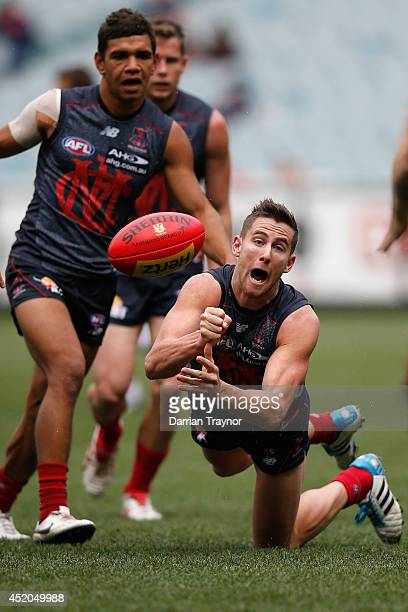 Jeremy Howe of the Demons handballs during the round 17 AFL match between the Melbourne Demons and the Geelong Cats at Melbourne Cricket Ground on...