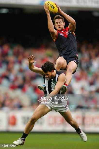 Jeremy Howe of the Demons marks the ball over Alex Fasolo of the Magpies during the round 12 AFL match between the Melbourne Demons and the...