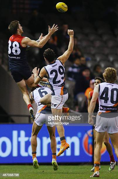 Jeremy Howe of the Demons marks the ball over Lachie Whitfield of the Giants during the round 23 AFL match between the Melbourne Demons and the...
