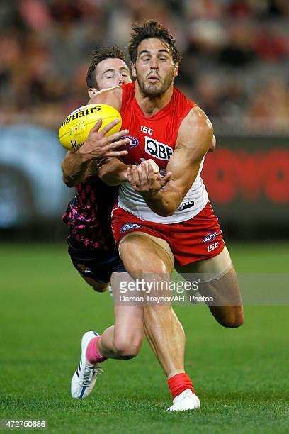 Jeremy Howe of the Demons spoils Josh Kennedy of the Swans during the round six AFL match between the Melbourne Demons and the Sydney Swans at...