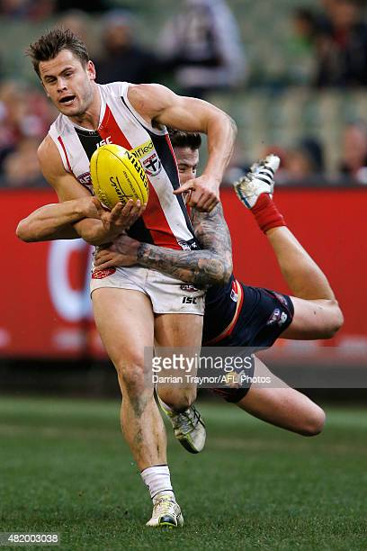 Jeremy Howe of the Demons tackles Maverick Weller of the Saints during the round 17 AFL match between the Melbourne Demons and the St Kilda Saints at...
