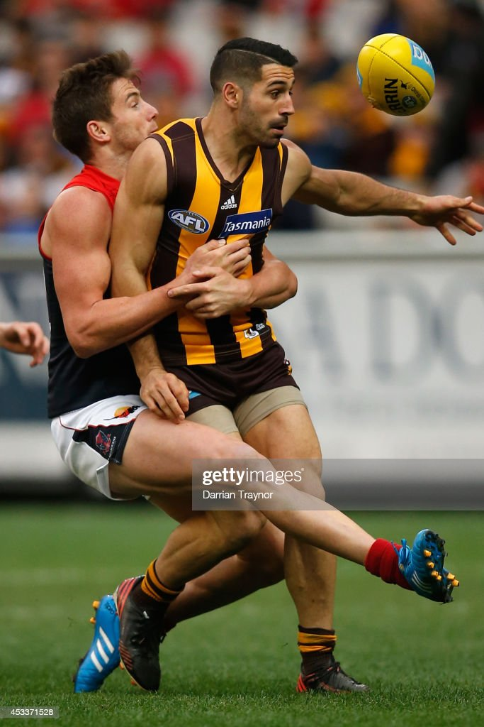 Jeremy Howe of the Demons tackles Paul Puopolo of the Hawks during the round 20 AFL match between the Hawthorn Hawks and the Melbourne Demons at Melbourne Cricket Ground on August 9, 2014 in Melbourne, Australia.