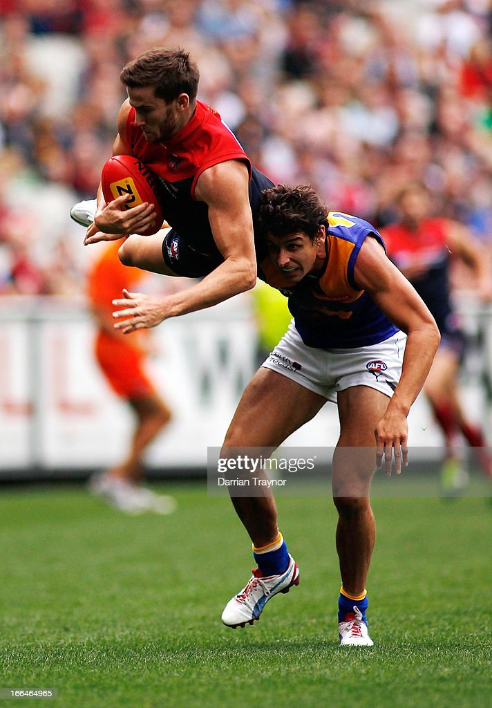Jeremy Howe of the Demons takes a high mark during the round three AFL match between the Melbourne Demons and the West Coast Eagles at Melbourne Cricket Ground on April 13, 2013 in Melbourne, Australia.