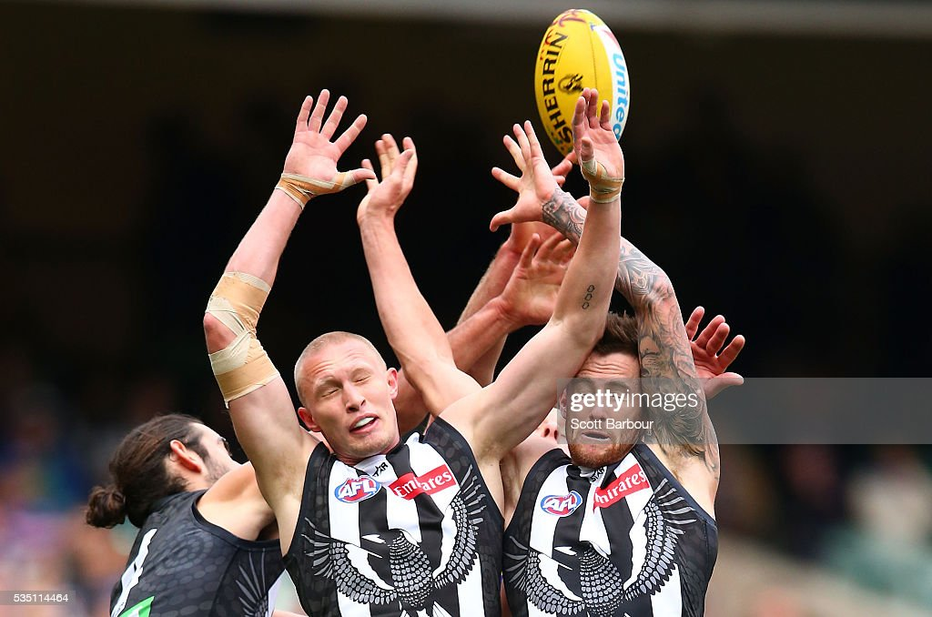 Jeremy Howe of the Magpies and Jack Frost of the Magpies compete for the ball during the round 10 AFL match between the Collingwood Magpies and the Western Bulldogs at Melbourne Cricket Ground on May 29, 2016 in Melbourne, Australia.