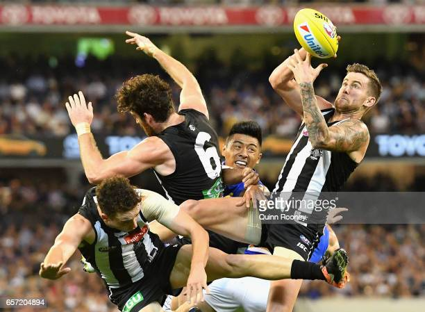 Jeremy Howe of the Magpies marks during the round one AFL match between the Collingwood Magpies and the Western Bulldogs at Melbourne Cricket Ground...