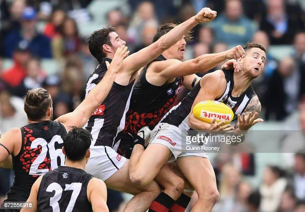 Jeremy Howe of the Magpies marks infront of Joe Daniher of the Bombers during the round five AFL match between the Essendon Bombers and the...