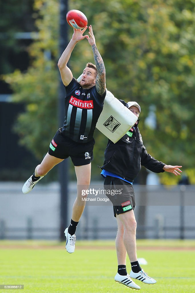 Jeremy Howe of the Magpies marks the ball during a Collingwood Magpies AFL training session on May 5, 2016 in Melbourne, Australia.